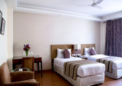 アルピナ ホテルズ & スイーツ - ニューデリー - 寝室