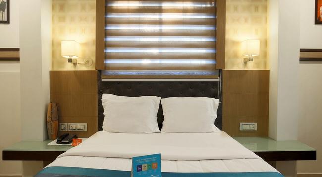 Fabhotel Monarch Jayanagar - バンガロール - 寝室