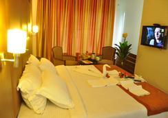 Fabhotel Tanisha Jubilee Hills - ハイデラバード - 寝室