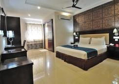 Fabhotel Majestica Inn Hitech City - ハイデラバード - 寝室