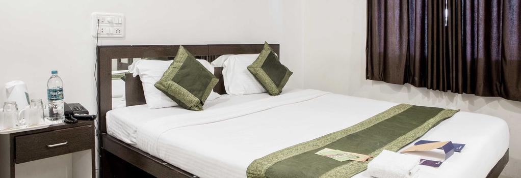 Fabhotel Midaas Comfort - ムンバイ - 寝室