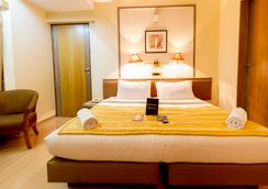 Fabhotel Gandharva Shivajinagar - プネ - 寝室