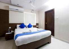 Fabhotel Myplace Kondapur Hicc - ハイデラバード - 寝室