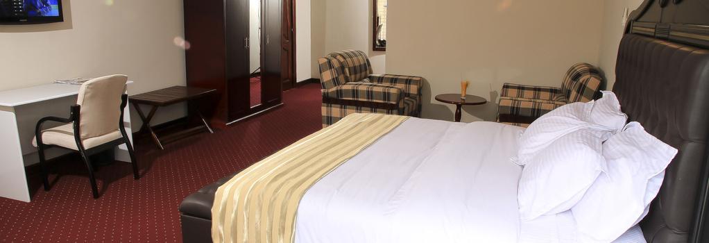 New Agena Hotel - Bujumbura - 寝室