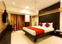 Prajwal By Mango Hotels - バンガロール - 寝室