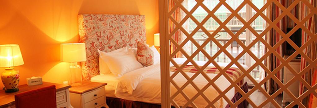 Michael's Inn & Suites - 陽朔 - 寝室