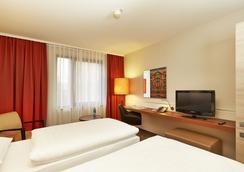 H+ Hotel Hannover - ハノーファー - 寝室