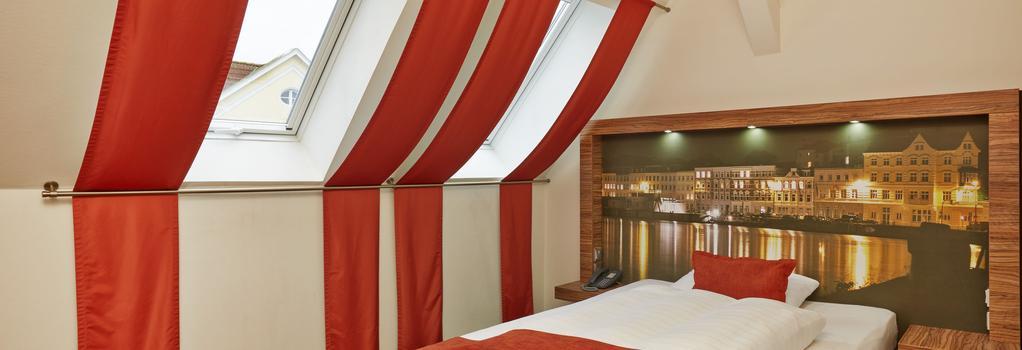 H+ Hotel Lübeck - リューベック - 寝室