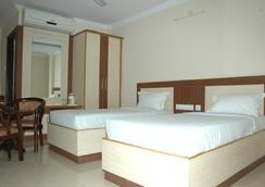 Hotel Sri Sai Regency - ハイデラバード - 寝室