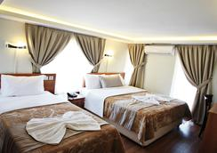 Taksim Palace Hotel - イスタンブール - 寝室