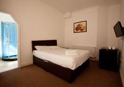 クランフォード ホテル - イルフォード - 寝室