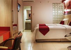 ファヴェホテル プレミア チハンペラス - バンドン - 寝室