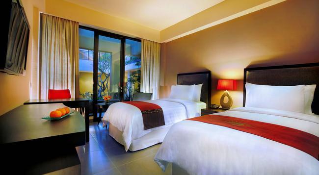 100 サンセット ホテル マネージド バイ イーグル アイズ - クタ - 寝室