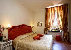 VOI ドンナ カミーラ サヴェッリ ホテル - ローマ - 寝室