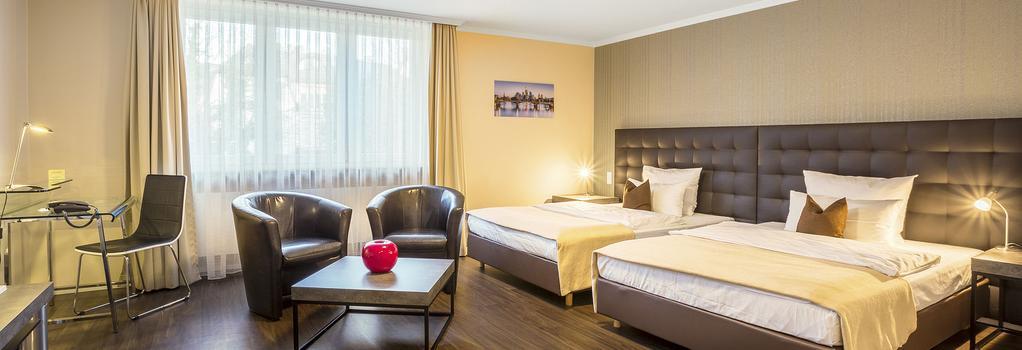 ホテル アン デア メッセ - フランクフルト - 寝室