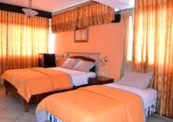 Hotel Malecon Inn - グアヤキル - 寝室