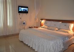 Nexus Resorts Hotel - Kampala - 寝室