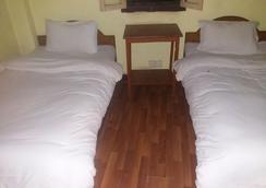 キングズ ランド ホテル ネパール - カトマンズ - 寝室