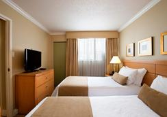 サンセット イン アンド スイーツ - バンクーバー - 寝室