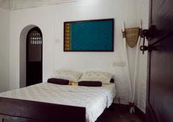 Inda Hotel - Varkala - 寝室