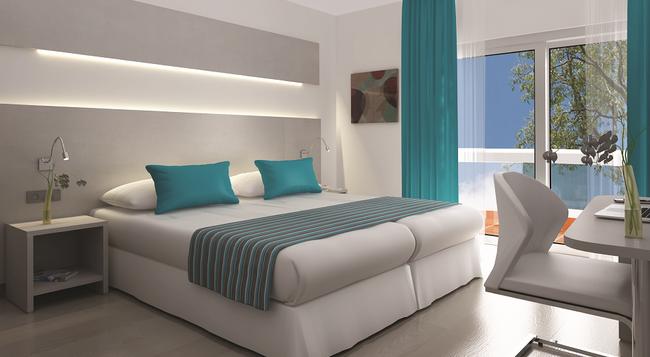 Hotel Fenix - エル・アレナル - 寝室
