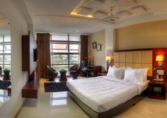 Hotel Rajmahal Inn - Mysore - 寝室