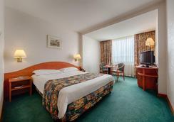 ラマダ パルク ホテル - ブカレスト - 寝室