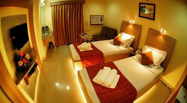 Hotel Pratap Plaza - チェンナイ - 寝室