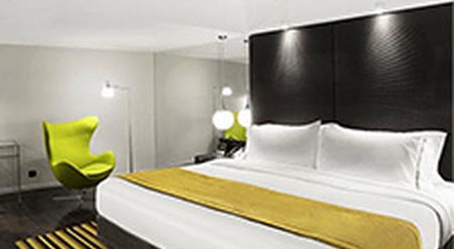 Uny Hotel - ジョグジャカルタ - 寝室