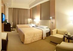 エバー デライトフル ビジネス ホテル - Chiayi City - 寝室