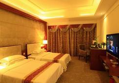 Nan Guo Hotel - 広州市 - 寝室
