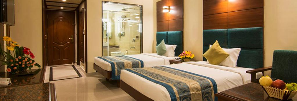 Shenbaga Hotel & Convention Centre - Puducherry - 寝室