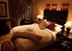 African Footprints Lodge - ブルームフォンテーン - 寝室