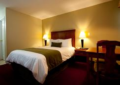 Riverland Inn & Suites - Kamloops - 寝室