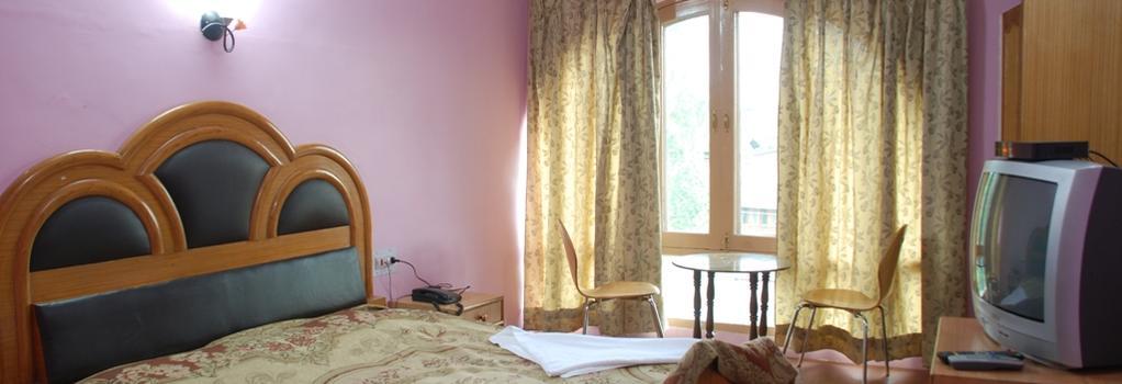 Hotel Shaneel Residency - Srinagar - 寝室