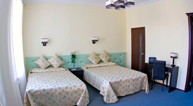 ロージズ ホテル - サンクトペテルブルク - 寝室