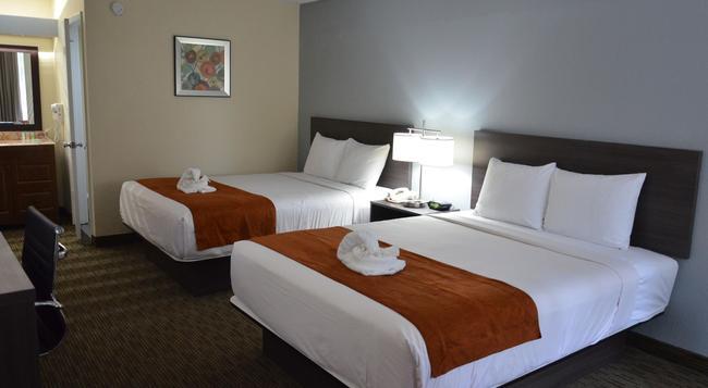 Days Inn & Suites Orlando Airport - オーランド - 寝室