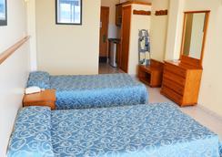 アパルタメントス トロピカル ガーデン - イビサ - 寝室