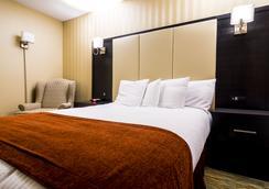 Sinbad's Hotel & Suites - Gander - 寝室
