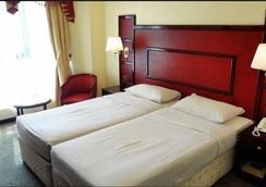 ニュー ペニンシュラ ホテル - ドバイ - 寝室
