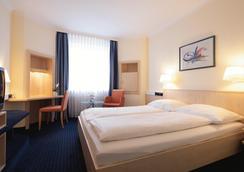 インターシティホテル フライブルク - Freiburg im Breisgau - 寝室