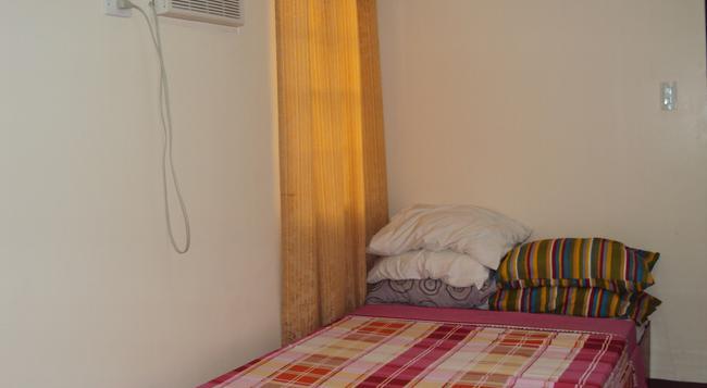 ハウス オブ トゥボ ダバオ - ダバオ - 寝室