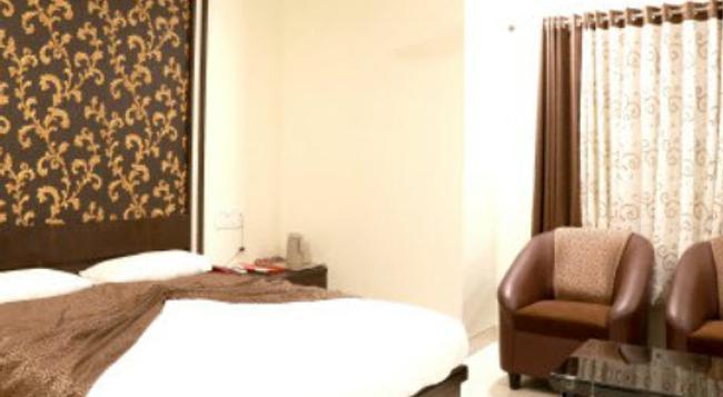 Hotel Ira Executive - アウランガーバード - 寝室