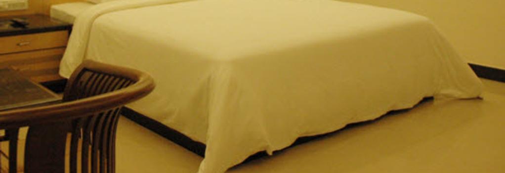 Oyo Premium Jayanagar Jain Temple - バンガロール - 寝室