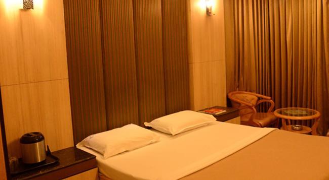 Hotel Raamus - コーヤンブットゥール - 寝室