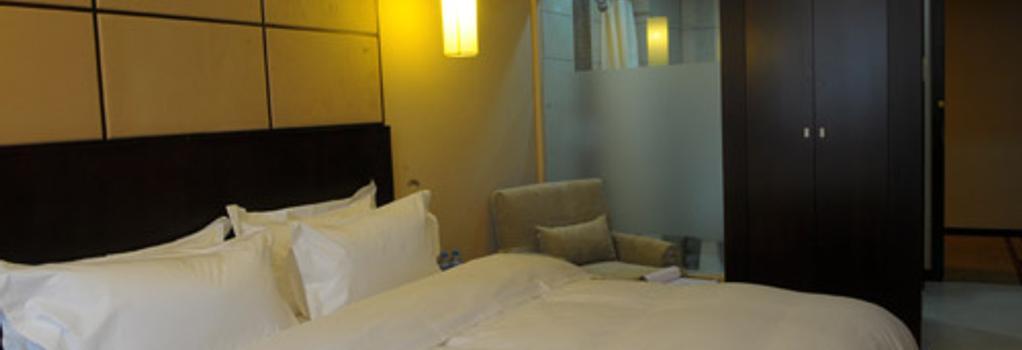 Baijia Hotel - 長春 - 寝室