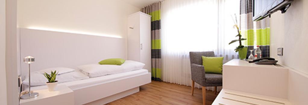 Hotel Restaurant Lamm - ヘッヒンゲン - 寝室
