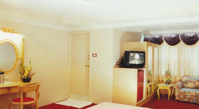 Hotel Swan Inn - プネ - 寝室