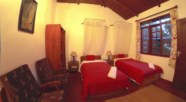 Safariland Cottages - Arusha - 寝室