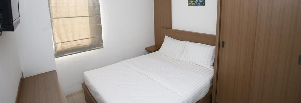 Reddoorz Near UOB Plaza - ジャカルタ - 寝室